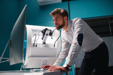 man works on alphashot micro
