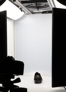 black sport shoe in 360 photography studio
