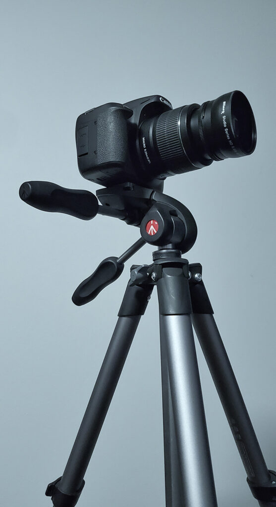 camera on a tripod for product photography of jewelery