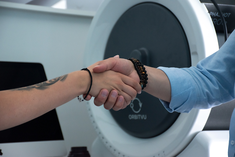 Handshake of a photographer and a model in a studio