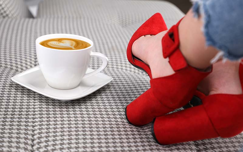 A shofie with cappuccino and red shoes